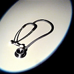 spotlighted stethoscope in black and white